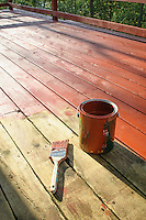 Re-staining old wooden deck DIY project painted into corner.