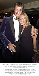 MISS ALICE BAMFORD daughter of Sir Anthony Bamford, and MR SEBASTIAN BAKER, at a ball in London on 15th May 2001.	OOE 91