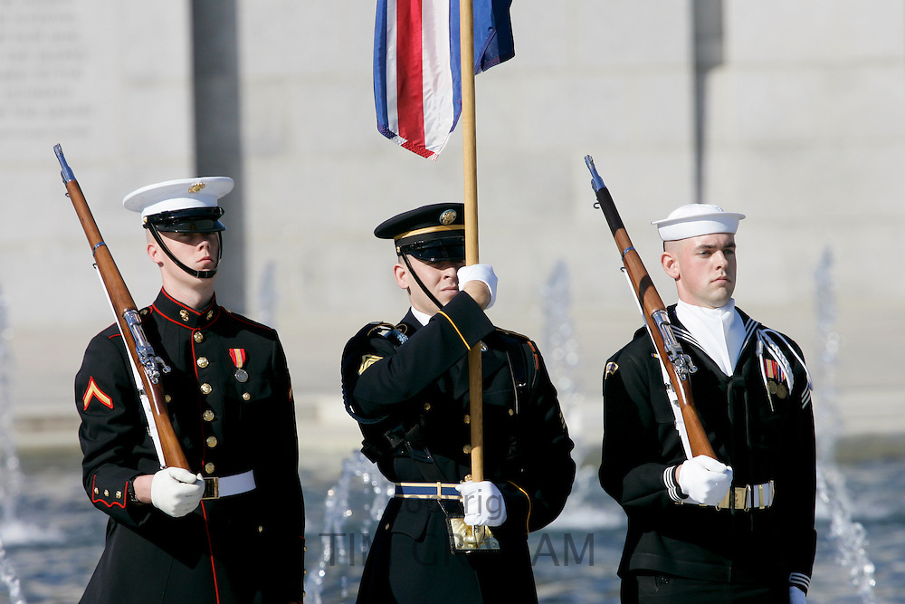US servicemen, army, airforce, marines and navy provide security at The National World War II Memorial, Washington DC, USA