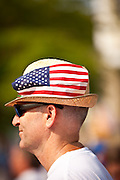 A man wears a patriotic hat in the I'On Community 4th of July parade.
