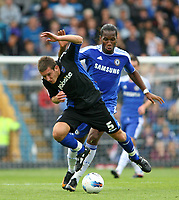 Football - Pre-Season Friendly - Portsmouth vs. Chelsea<br /> Portsmouth's Jason Pearce holds off Chelsea's Didier Drogba at Fratton Park during there pre-season friendly