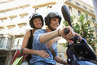 Young Couple Riding Motorscooter