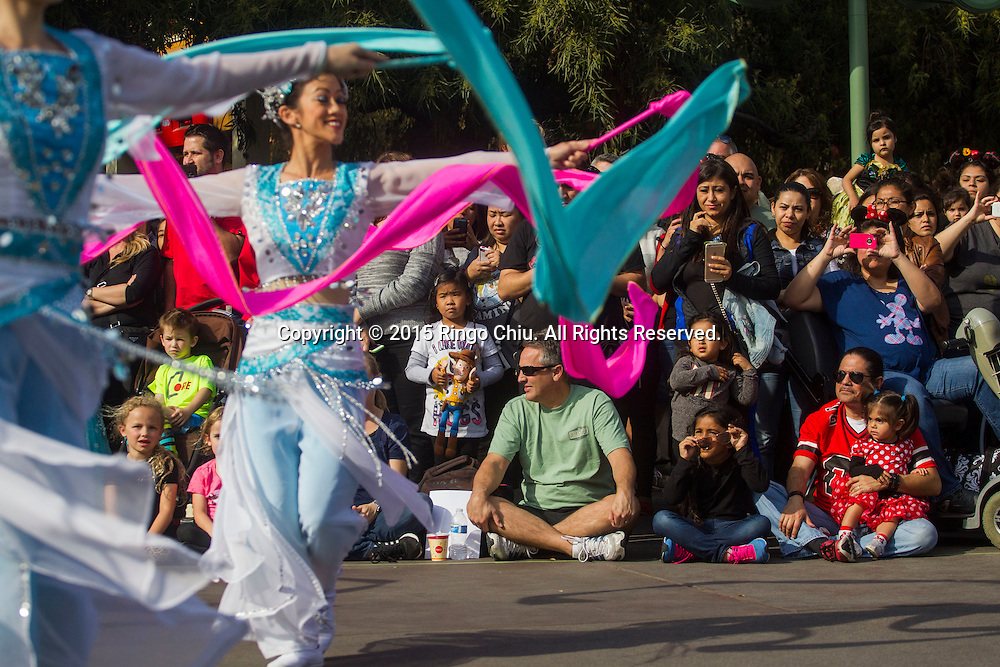 Guests watch as dancers perform at the Paradise Garden in Disney California Adventure Park during the Happy Lunar New Year Celebration on Saturday February 21, 2015 in Anaheim, California. (Photo by Ringo Chiu/PHOTOFORMULA.com)