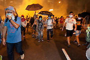 demonstrators running away from massive tear gas firing  <br /> Admiralty<br /> <br /> The streets of Hong Kong on Sunday night resemble a battleground, with police in full riot gear and gas masks firing tear gas on students wearing makeshift masks and wielding umbrellas, in the worst clashes between police and demonstrators since the 2005 WTO protests