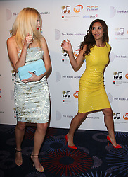 (L-R) PIXIE LOTT with MYLEENE KLASS arrives for the Radio Academy Awards, London, United Kingdom. Monday, 12th May 2014. Picture by i-Images