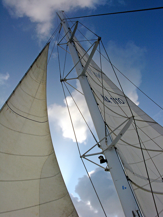 Mast of a sailboat.