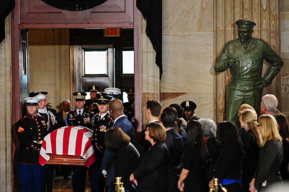 A military honor guard carries the casket of the late Senator Daniel Inouye (D-HI) into the U.S. Capitol Rotunda before a service and public viewing on Thursday. Inouye passed away at the age of 88 on December 18 at the Walter Reed National Military Medical Center in Bethesda, Md. Inouye, 88, a decorated World War II veteran and the second-longest serving senator in history will lie in state until Friday when a memorial service will be held at the National Cathedral.