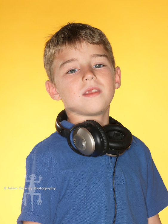 Caucasian boy listens to music with an iPod and headphones