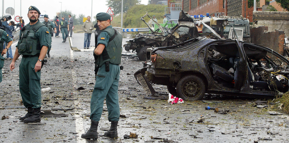 Civil guards inspect car bomb wreckage that exploded early 24 August 2007 outside the barracks of Spain's paramilitary Guardia Civil in the northern town of Durango in the Basque region. Spanish media suggested the attack was likely the work of ETA, although nobody immediately claimed responsibility. Two people were reportedly injured. PHOTO RAFA RIVAS