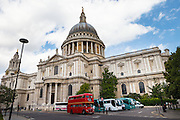 Traditional Doubledecker bus passing St Pauls Cathedral, London, UK