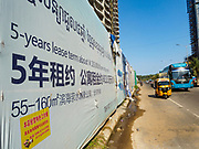 "15 FEBRUARY 2019 - SIHANOUKVILLE, CAMBODIA:  Traffic goes past Blue Bay Resort and Casino, a Chinese development in Sihanoukville. There are about 80 Chinese casinos and resort hotels open in Sihanoukville and dozens more under construction. The casinos are changing the city, once a sleepy port on Southeast Asia's ""backpacker trail"" into a booming city. The change is coming with a cost though. Many Cambodian residents of Sihanoukville  have lost their homes to make way for the casinos and the jobs are going to Chinese workers, brought in to build casinos and work in the casinos.      PHOTO BY JACK KURTZ"