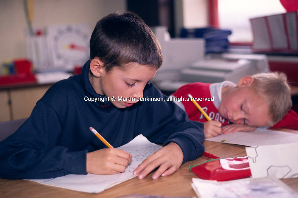 Primary (Junior) schoolchidren writing in a classroom....© Martin Jenkinson tel 0114 258 6808  mobile 07831 189363 email martin@pressphotos.co.uk  NUJ recommended terms & conditions apply. Copyright Designs & Patents Act 1988. Moral rights asserted credit required. No part of this photo to be stored, reproduced, manipulated or transmitted by any means without prior written permission.