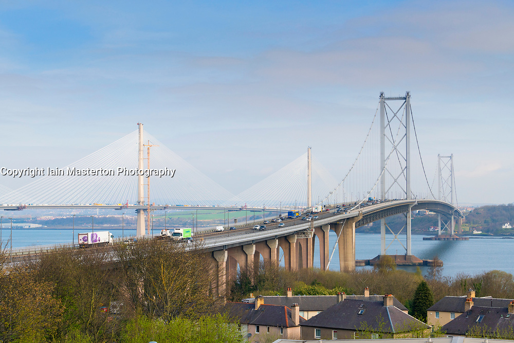 View of Forth Road Bridge and new Queensferry Bridge in distance under construction from South Queensferry, Scotland, United Kingdom