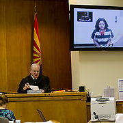 Perla Caroline Morales has been indicted on murder charges in the shooting of her two children Emma and Richard Rosivich. She appears in a recent court hearing with Pima Co. Superior Court, Judge Roger L. Duncan, to enter a not-guity plea from jail.