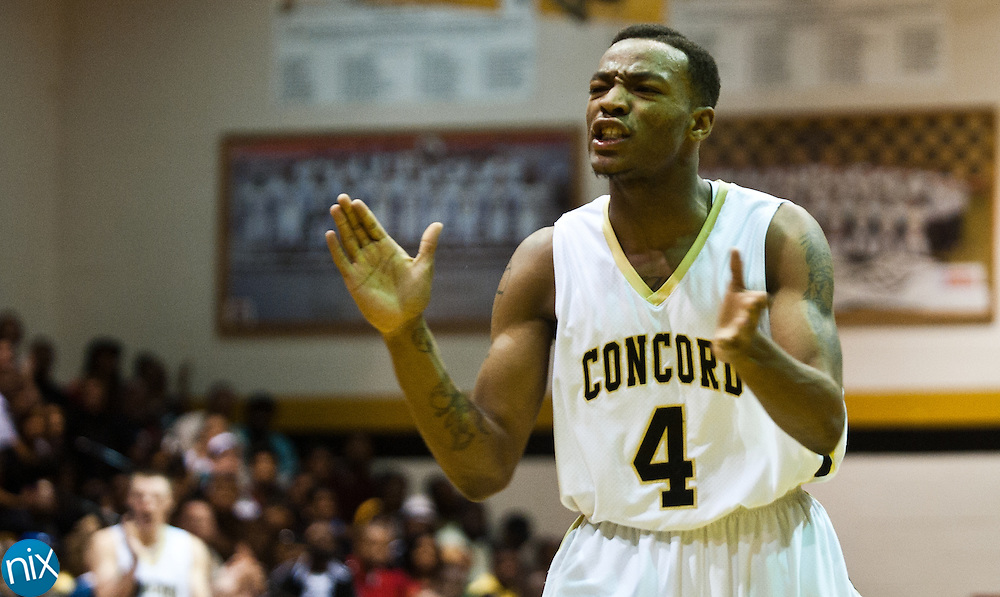 Concord's Jacquise Moore cheers as his team builds on their lead against Kannapolis Friday night at Concord High School. Concord won the game 77-51 to finish the season on top of the South Piedmont Conference. The SPC tournament starts next week. (Photo by James Nix)