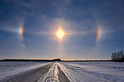 Sundogs and country road on prairie landscape<br />