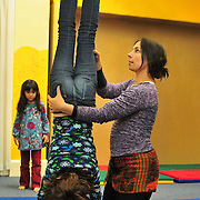12/15/10 -- BATH, Maine. Kari McKenna of Universe Gym in Bath helps one of her students perform a handstand as part of her afterschool program. © 2010 by Roger S. Duncan.