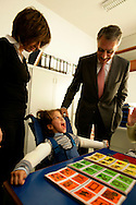 """Cavaco Silva (right) and Katia Guerreiro (left) visiting an institute for handicaped children in Coimbra. Katia Guerreiro is the Youth Representant in Cavaco Silva's campaign and she is one of the leading new """"Fado"""" singers."""
