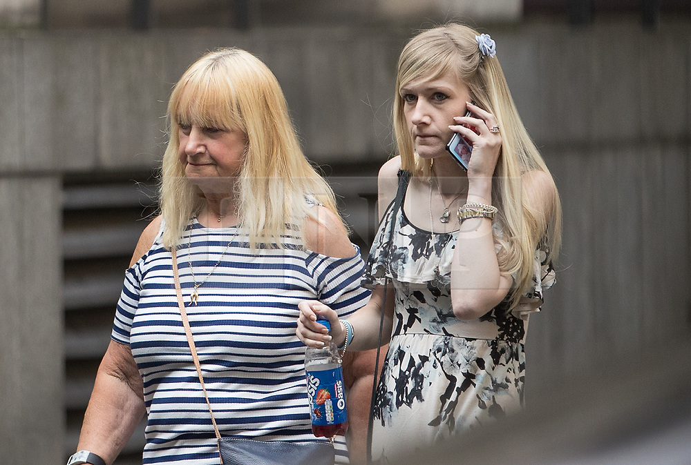 © Licensed to London News Pictures. 25/07/2017. London, UK. CONNIE YATES (R) makes a phonecall during a break in proceedings at The The Royal Courts of Justice in London . The parents of terminally ill Charlie Gard have returned to court in an attempt to take their terminally ill son home to die rather than ending his life in hospital. Yesterday a court ruled that Charlie, who suffers from a rare genetic condition known as mitochondrial DNA depletion syndrome, should not be taken to US for further treatment. Photo credit: Peter Macdiarmid/LNP