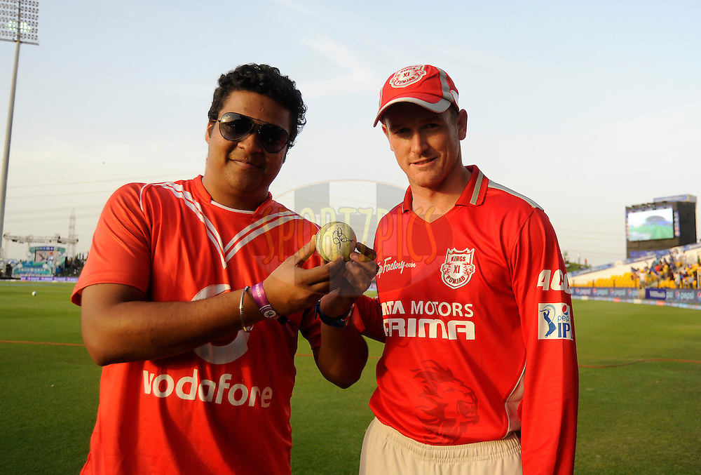 Vodafone Winner(L) with George Bailey of the Kings X1 Punjab during the presentation after match 3 of the Pepsi Indian Premier League Season 7 between the Chennai Superkings and the Kings X1 Punjab held at the Al Zayed Cricket Stadium, Abu Dhabi, United Arab Emirates on the 18th April 2014<br /> <br /> Photo by Pal Pillai / IPL / SPORTZPICS