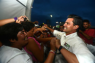 Cancun, Mexico - Leading Mexican Presidential candidate Enrique Peña Nieto, the fresh, movie-star face of the country's old PRI party, is energized shaking hands with women in the resort city of Cancun in the Mexican state of Quintana Roo. The PRI ruled Mexico for 70 years and is associated with entrenched corruption but many Mexicans are embracing its return, exhausted from violence they blame on President Felipe Calderon's conservative PAN party and its war against drug cartels. (PHOTO: MIGUEL JUAREZ LUGO)