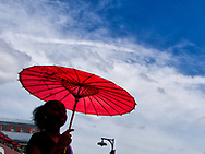 Lady with a red parasol at Southstreet Seaport, New York City