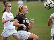 FAIRLESS HILLS, PA -  OCTOBER 3: Conwell Egan's Amy Meyer (32) chases St. Hubert's Jessica Elliott (4) as she dribbles the ball during a girls soccer game October 3, 2013 in Fairless Hills, Pennsylvania.  (Photo by William Thomas Cain/Cain Images)