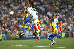 August 27, 2017 - Madrid, Spain - Benzema heads on goal. LaLiga Santander matchday 2 between Real Madrid and Valencia. The final score was 2-2, Marco Asensio scored twice for Real Madrid. Carlos Soler and Kondogbia did it for Valencia. Santiago Bernabeu Stadium, august 27, 2017. Photo by  (Credit Image: © |Antonio Pozo |  Media Expre/VW Pics via ZUMA Wire)