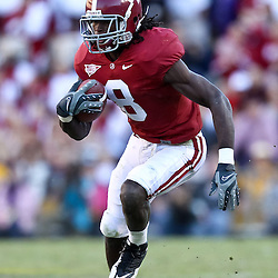 November 6, 2010; Baton Rouge, LA, USA;  Alabama Crimson Tide wide receiver Julio Jones (8) runs after a catch during the second half against the LSU Tigers at Tiger Stadium. LSU defeated Alabama 24-21.  Mandatory Credit: Derick E. Hingle