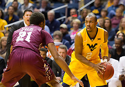 Dec 21, 2015; Morgantown, WV, USA; West Virginia Mountaineers guard Jevon Carter (2) looks to make a move around Eastern Kentucky Colonels guard JaVontae Hawkins (21) during the first half at the WVU Coliseum. Mandatory Credit: Ben Queen-USA TODAY Sports