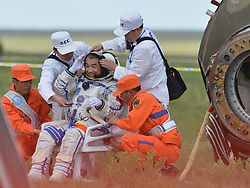 59902230  <br /> Astronaut Zhang Xiaoguang salutes after going out of the re-entry capsule of China s Shenzhou-10 spacecraft following its successful landing at the main landing site in north China's Inner Mongolia Autonomous region on June 26, 2013. Photo by imago / i-Images.<br /> UK ONLY
