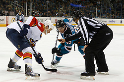 Dec 3, 2011; San Jose, CA, USA; NHL linesman Thor Nelson (80) drops the puck to San Jose Sharks center Logan Couture (39) and Florida Panthers center Shawn Matthias (18) on a face off during the first period at HP Pavilion. Florida defeated San Jose 5-3. Mandatory Credit: Jason O. Watson-US PRESSWIRE