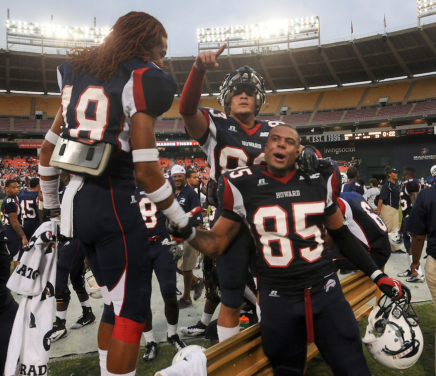 Washington DC--Howard University tightend David Wilson (85) is congratulated by teammate Stewart Hartman (18) after scoring a come from behind touchdown with only 22 seconds left in the 4th quarter of the AT&T Nation's Football Classic Saturday afternoon at RFK Stadium in Washington, DC . Howard University defeated Morehouse College 30-29.  (Photo by Alan Lessig)