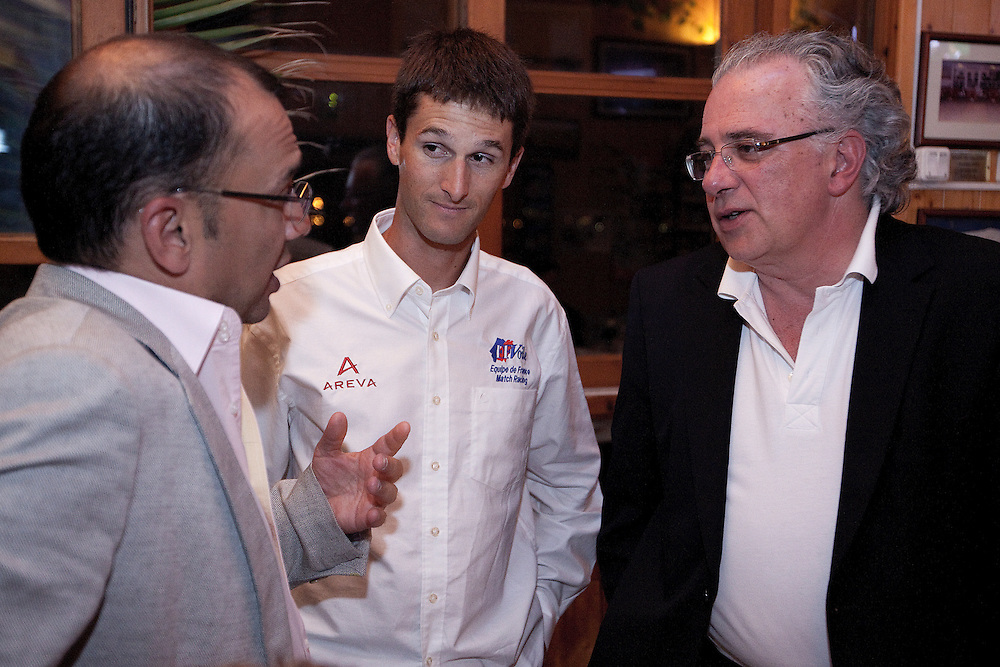 Mathieu Richard talks with Patrick Lim and Luis Carito at a dinner for skippers and VIPs. Portimao Portugal Match Cup 2010. World Match Racing Tour. Portimao, Portugal. 26 June 2010. Photo: Gareth Cooke/Subzero Images