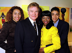 Centre, singer PATTI BOULAYE and her husband MR STEPHEN KOMLOSY with their children MISS EMMA KOMLOSY and MR SEBASTIAN KOMLOSY, at an exhibition in London on 23rd September 1999.MWS 8
