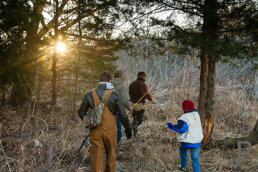 The Hanks family - Camron, Mark, Tyler and Lane - head for their favorite fishing spot on the Blue River near Tishomingo, Oklahoma in 20 degree winter weather.