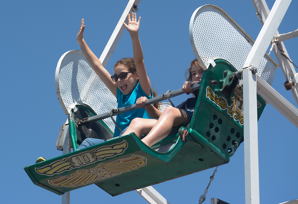 gbs060417k/ASEC -- Ella Schaller, 9,  and Claudia Aragon, 10, ride the Ferris Wheel in Old Town Plaza during the San Felipe de Neri Fiesta on Sunday, June 4, 2017. (Greg Sorber/Albuquerque Journal)