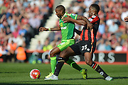 AFC Bournemouth's defender Sylvain Distin (right) tackles Sunderland AFC striker Jermain Defoe during the Barclays Premier League match between Bournemouth and Sunderland at the Goldsands Stadium, Bournemouth, England on 19 September 2015. Photo by Mark Davies.