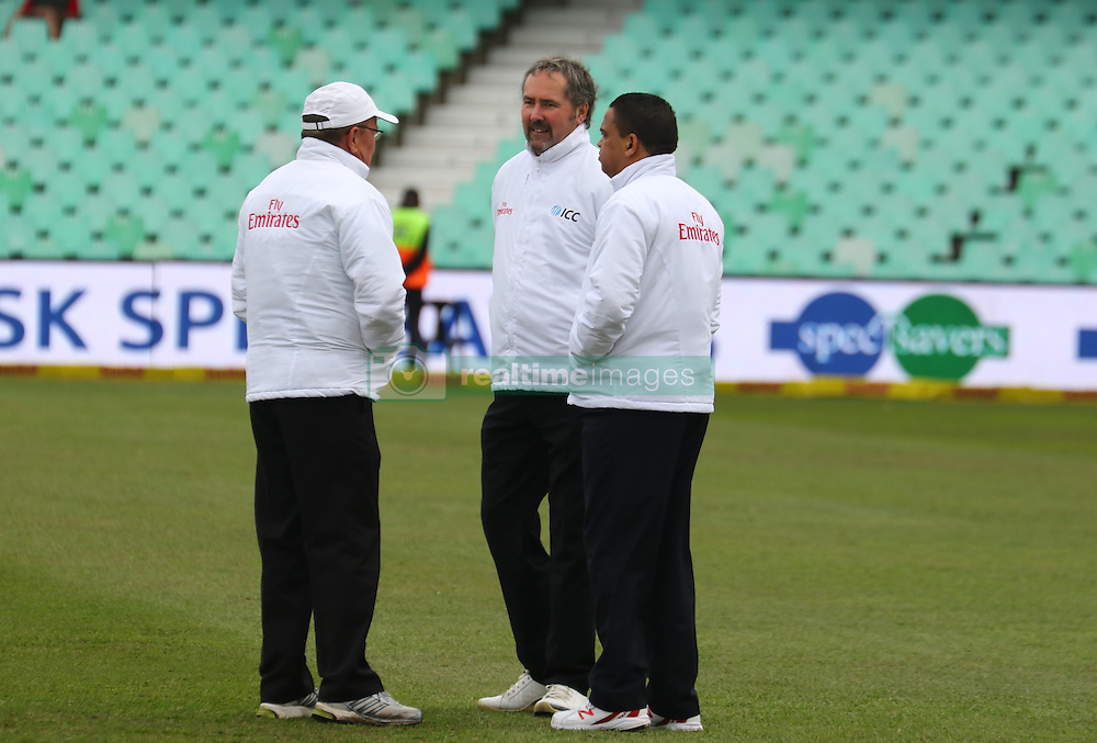 Umpires discuss their field inspection during day four of the first test match between South Africa and New Zealand held at the Kingsmead stadium in Durban, KwaZulu Natal, South Africa on the 22nd August 2016<br /> <br /> Photo by:   Anesh Debiky / Real Time Images