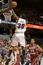 Virginia forward Adrian Joseph (30) leaps for a dunk against BC.  The Virginia Cavaliers men's basketball team defeated the Boston College Golden Eagles 84-66 at the John Paul Jones Arena in Charlottesville, VA on January 19, 2008.