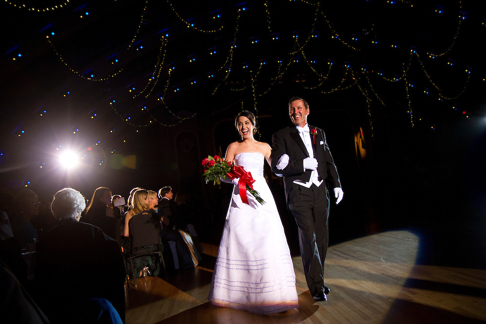Caption:(Wednesday 12/28/2011 St. Petersburg) Mary Elizabeth Keegan and her father, Joseph Patrick Keegan react to a cheer from the crowd during The Presentation Ball, hosted by the St. Petersburg Debutante Club. The annual event, which began in 1937, was held at The Colisuem in St. Petesburg on Wednesday Dec. 28, 2011...Summary:The Presentation Ball, hosted by the St. Petersburg Debutante Club. ..Photo by James Branaman