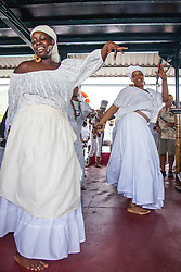 (L-R) Jahweh David and Marie Paul dance to one ofthe traditional bamboula songs aboard the Kon Tiki as the tour travels from St. Thomas to Hassel Island and back.  9th Annual Dollar Fo' Dollar Culture and History Tour, a remembrance of the 1892 Coal Workers Strike on St. Thomas.  20 September 2014.  St. Thomas, USVI.  © Aisha-Zakiya Boyd