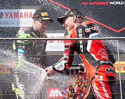 February 25, 2018 - Melbourne, Victoria, Australia - British rider Jonathan Rea (#1) of Kawasaki Racing Team and Italian rider Marco Melandri (#33) of Aruba.it Racing - Ducati spray champagne after the second race on day 3 of the opening round of the 2018 World Superbike season at the Phillip Island circuit in Phillip Island, Australia. (Credit Image: © Theo Karanikos via ZUMA Wire)