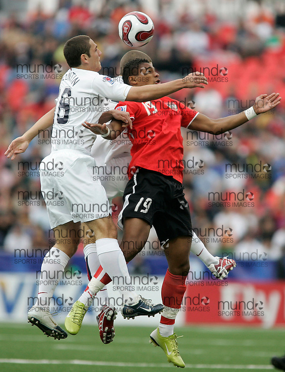 Asutria's Rubin Okotie(R) jumps to head the ball against the USA's Julian Valentin during the first half their match at the FIFA U-20 World Cup on 14 July 2007 in Toronto, Ontario, Canada.  The teams were tied 1-1 at the half..AFP PHOTO/GEOFF ROBINS