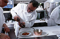February 1997, Monte-Carlo, Monaco --- Chef Grinding Pepper Over a Dish of Food --- Image by © Owen Franken/CORBIS
