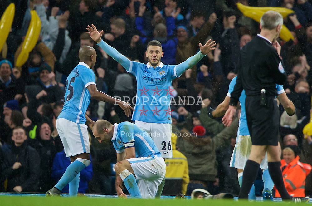 MANCHESTER, ENGLAND - Wednesday, January 27, 2016: Manchester City's Martin Demichelis celebrates his side's 3-1 (4-2 on aggregate) victory over Everton during the Football League Cup Semi-Final 2nd Leg match at the City of Manchester Stadium. (Pic by David Rawcliffe/Propaganda)