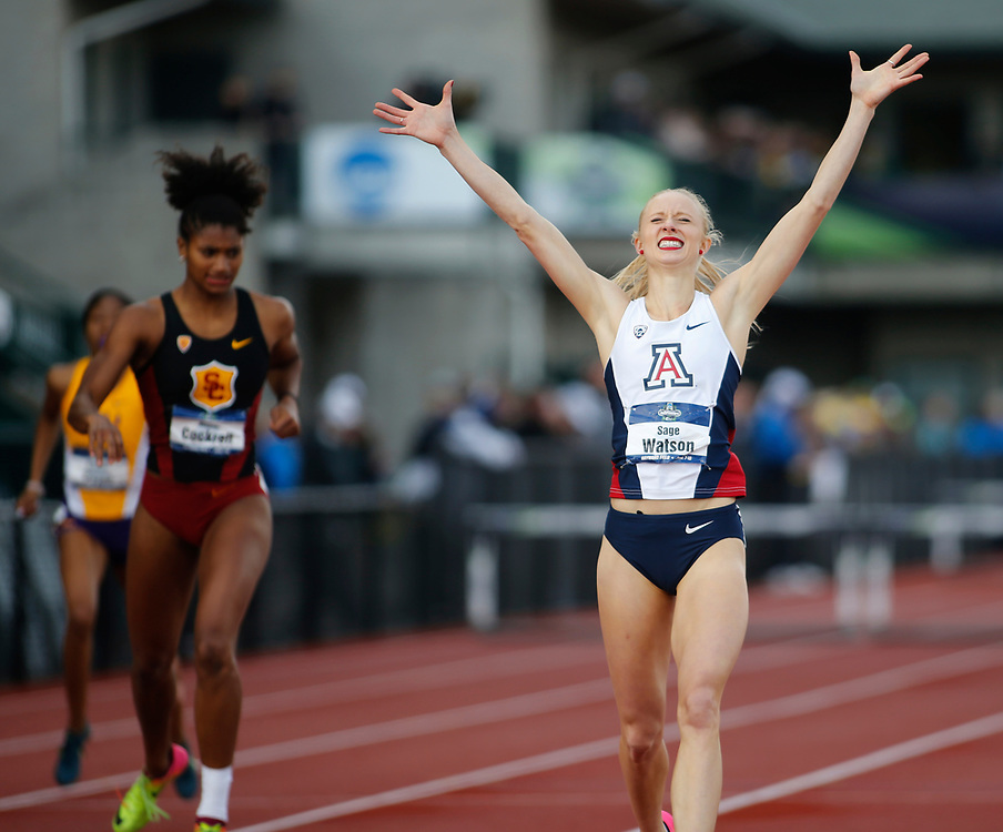 Arizona's Sage Watson, right, raises her arms in victory as she beats USC's Anna Cockrell to win the women's 400 meter hurdles in the tme of 54.52 seconds on the final day of the NCAA outdoor college track and field championships in Eugene, Ore., Saturday, June 10, 2017. (AP Photo/Timothy J. Gonzalez)