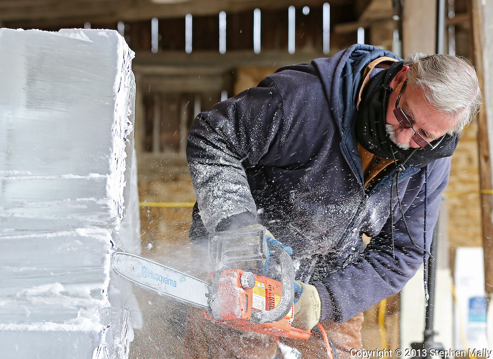 Mercy executive chef Ron Hall works on an ice sculpture during Winterfest at the Amana Colonies in Amana on Saturday, January 26, 2013.