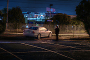 Railway Stations at night. West Footscray. About 7:30pm A man in the carpark finishes his cigarette while studying me from a distance, as I am in the shadow of a tree. Pic By Craig Sillitoe CSZ/The Sunday Age/The Age iPad App.15/6/2011 This photograph can be used for non commercial uses with attribution. Credit: Craig Sillitoe Photography / http://www.csillitoe.com<br />