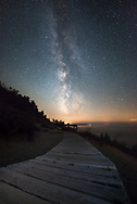 The core of the Milky Way shines brilliantly over the Lake Michigan shore, as seen from Empire Bluff. <br />